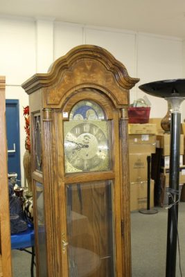 Howard Miller Grandfather Clock at Powell Auction